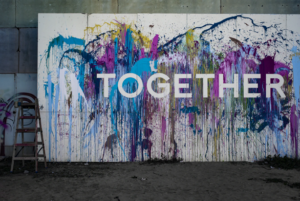 A painting featuring the word 'together'